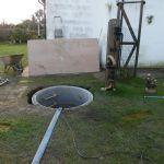 hand dug well next to antique well pump